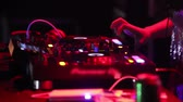 NHA TRANGVIETNAM - JULY 25 2015: Closeup music mixer console and girl dj hands play modern music under flashing lights in nightclub on July 25 in Nha Trang