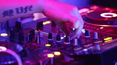NHA TRANGVIETNAM - JULY 25 2015: Close view girl dj with large modern tattoos on hands in brilliant silver top works at music console on stage on July 25 in Nha Trang