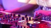 alavanca : NHA TRANGVIETNAM - JULY 25 2015: Closeup girl dj hand with bracelets moves levers on music mixer console playing music under flashing lights in club on July 25 in Nha Trang