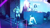NHA TRANGVIETNAM - JULY 25 2015: Nice girls go-go dancers in frank dresses dance and do tricks on stage to famous dj music at nightclub party on July 25 in Nha Trang