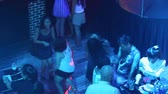 NHA TRANGVIETNAM - JULY 25 2015: Upper view joyful youth dance on large floor under neon flashing lights in popular night club on July 25 in Nha Trang Vídeos