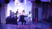 NHA TRANGVIETNAM - JULY 25 2015: Beautiful long haired go-go girls on high heals dance at popular dj music set on night club stage on July 25 in Nha Trang Vídeos