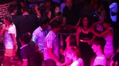 NHA TRANGVIETNAM - JULY 25 2015: Happy young asian clubbers dance and have fun on dancefloor at projectors light in popular club on July 25 in Nha Trang