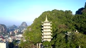 inspiring bird eye view buddhist temple with pagodas on green mountain slope near large modern city