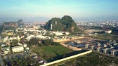 wonderful aerial panorama large morning city and single forestry hill with temple pagoda under pictorial blue sky
