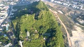 beautiful upper view traditional asian buddhist temple pagodas on high green hill among modern city 動画素材