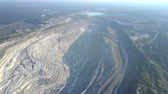 pedreira : pictorial high aerial panorama asbestos open cast mining quarry among landscape with modern city lake and forests