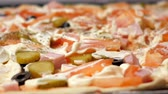 majonéz : slow motion closeup woman sprinkles herbs to raw homemade pizza with different vegetables and mayonnaise
