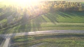 mısır tarlası : amazing aerial view empty fields crossed by roads near trees against bright sunlight on nice autumn day