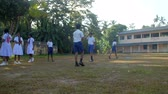 schoolplein : ColomboSRI LANKA - APRIL 05 2019: Schoolboys prepare to game on playground against school building and schoolgirls look at players slow motion. Concept sport and competition on April 05 in Colombo