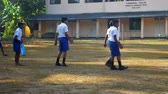 schoolplein : ColomboSRI LANKA - APRIL 05 2019: Schoolboys walk along playground against school building on last day slow motion. Concept sport and competition on April 05 in Colombo