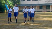 schoolplein : ColomboSRI LANKA - APRIL 05 2019: Happy boys in uniforms walk along playground with cricket equipment slow motion. Concept healthy sport and competition on April 05 in Colombo