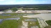 agressivo : wide swampy land and clear lakes with spits at large sand pit near green forest bird eye view. Concept ecosystem disturbance