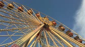 charneca : Low Angle Wide Shot of Ferris Wheel at German Fun Fair (4K)