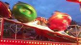 charneca : BERLIN, Germany - JUNE 3, 2017: Funfair Ride (Flea Market) Flipper at German Fun Fair (Fair) at night - Closer 4K