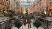 urbane : Berlin, Germany - December 2nd, 2018: Potsdamer Platz Arcades Shopping Mall in Christmas Decoration with Christmas Tree, Garlands and Lights.