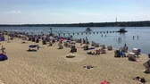 kayıtlar : Berlin, Germany - May 29,2018: Pan over people enjoying the hot weather at Wannsee