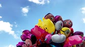 кинозвезды : Krakow, Poland - 29 July 2017: Group of balloons in the shape of the famous cartoon characters against blue sky