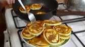 Cooking pancakes in home kitchen, dough, hot pan and stove Stock mozgókép