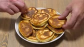 Quickly grabbing a delicious pancakes from the plate, a big hungry family and a lot of hands Stock mozgókép