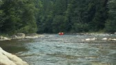 Group of people rafting on the rapids river, Carpathian mountains Stock mozgókép
