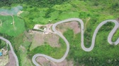 sarma : The aerial view of winding road from high mountain pass in Phutabberk, Thailand, Curved road view by drone.