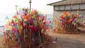 manevi : A colorful flags on sandy pagoda in Thai Songkran Festival, Thailand