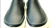klapki : Black rubber casual shoes on white background