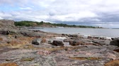 Rocky coast of the island of Suomenlinna, Helsinki, Finland. The ship sails on the sea. Стоковые видеозаписи