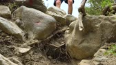 pedregulhos : A young traveler descends the mountain stony path. Close up. Stock Footage