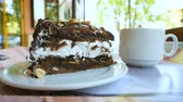 amendoins : Closeup of a dessert in a street cafe. Chocolate cake with whipped cream and toasted peanuts.