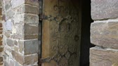 железо : Antique medieval restored wooden door with metal plates. Стоковые видеозаписи