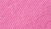 繊維 : Textile background - pink 100 cotton cloth with jersey (stockinette) structure. Weave pattern of threads close up.