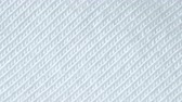 ステッチ : Textile background - white cotton fabric with jersey (stockinette) structure. Weave pattern of threads close up.