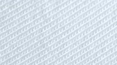 tricots : Textile background - white cotton fabric with jersey (stockinette) structure. Weave pattern of threads close up.