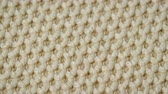 бежевый : Cotton fabric footer beige color with weave pique. Macro shoot. Close up. Стоковые видеозаписи