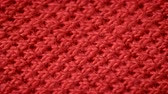 ステッチ : Red cotton fabric with polyester, which is used for sewing polo shirts. Weave a pike. Macro shoot. Close up.