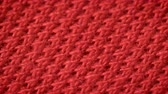 tricots : Red cotton fabric with polyester, which is used for sewing polo shirts. Weave a pike. Macro shoot. Close up.
