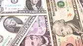 pagare : Banknotes in denominations of one to ten USA dollars. Rotation paper money close-up.
