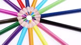 cores vibrantes : Multicolored colorful childrens pencils rotate on a white background. Close up. Stock Footage