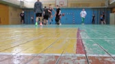 teenage boys : Basketball game. Teens train in the school old sports hall, throw the ball in the basket and run with the ball.