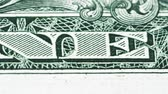 Sliding video of a one US dollar bill note, showing One Dollar text. Macro shot. Close up. Vidéos Libres De Droits