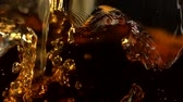 кубик льда : Pouring brown color liquid shooting with high speed camera, phantom flex.