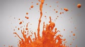 fundo colorido : Orange paint bouncing and making splash. Shot with high speed camera, phantom flex 4K.  Slow Motion. Stock Footage