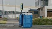 movable : Blue public toilet at empty street of innopolis city