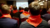 estratégico : Meeting of the Communist pioneers Komsomol - listeners in red ties listens for lecturer who tells and shows presentation on screen