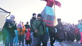 festividades : Sviyagsk, Russia - 26 February 2017: The pancake week - Russian ethnical carnival - Maslennica - the crowd carries the effigy of winter to burn, snow sunny day