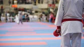 knocking : Sports teenagers - kid sportsmen at karate tatami - ready for fight