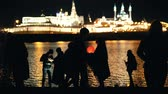 burn : Kazan, Russia, 12 may 2017 - silhouette loving couple at festival of floating Lanterns on Kazanka Stock Footage