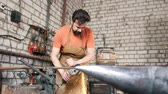 humanhand : A muscular man working with a circular saw in the forge Stock Footage